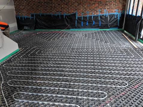 Energy efficient home, in-screed circuits