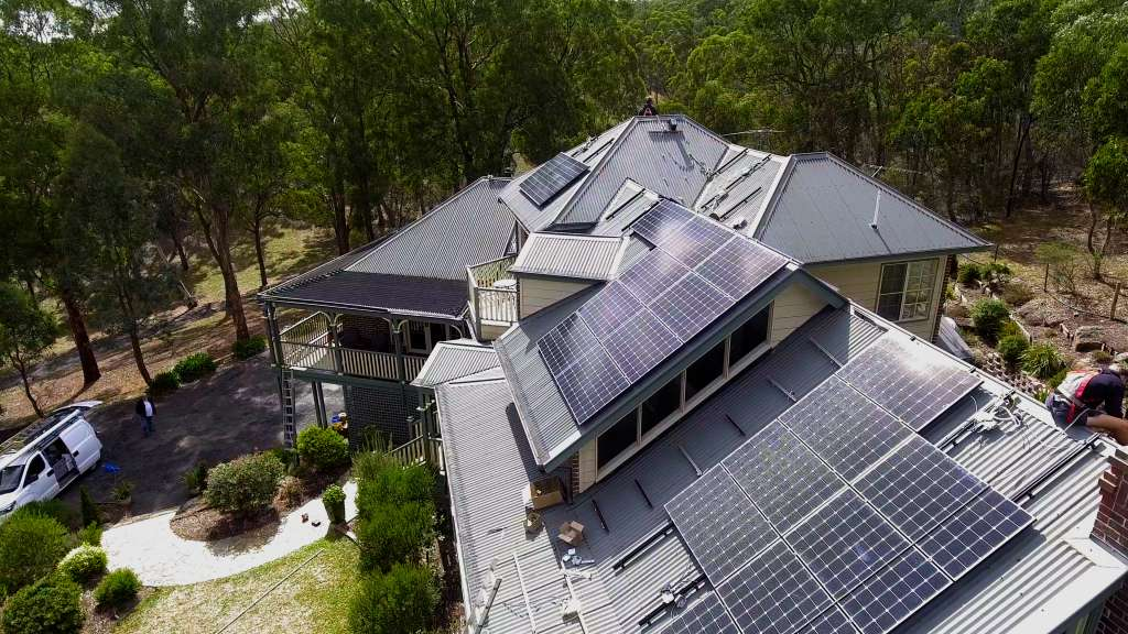 Image of off-grid solar panel installation maximizing roof space and orientation