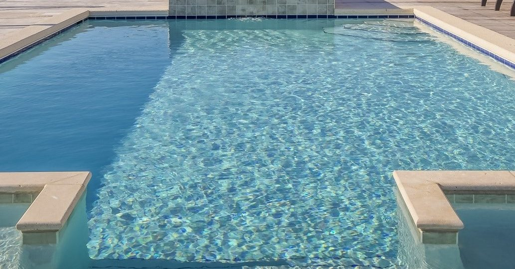Image of a large swimming pool with spa